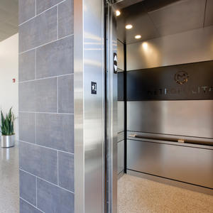 LEVELe-104 Elevator Interior: Capture panels in Fused Graphite, Mirror finish