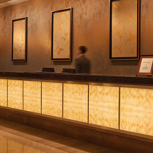 Registration desk in backlit ViviStone Honey Onyx