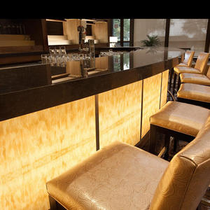 Bar front in backlit ViviStone Honey Onyx