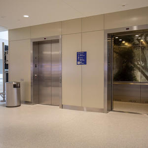 Elevator interior panels: ViviSpectra Spectrum glass with custom interlayer