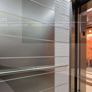 LEVELe-103 Elevator Interior with panels in Stainless Steel with Seastone finish