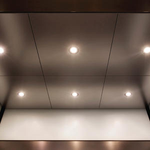 Elevator ceiling in Stainless Steel, Sandstone finish, with LED downlights