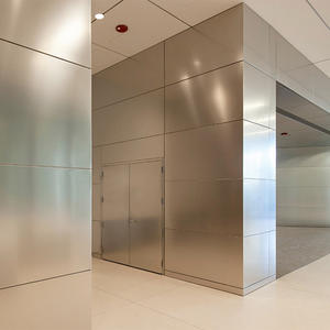 LEVELe Wall System with Float panels and custom panels in Stainless Steel