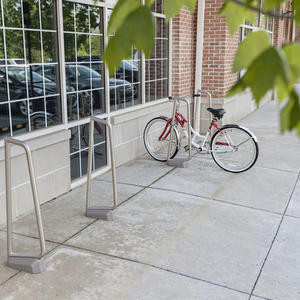 Summit Bike Racks shown in surface mount configuration with bodies in Stainless