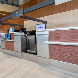 Ticket counter panels in Bonded Metal in custom color with Natural Patina