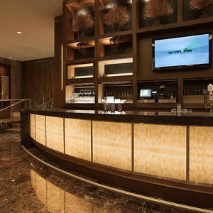 Bar front and column accents in backlit ViviStone Honey Onyx