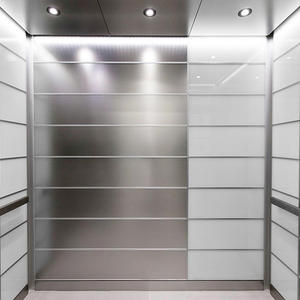 LEVELe-103 Elevator Interior with main panels in Stainless Steel Seastone finish