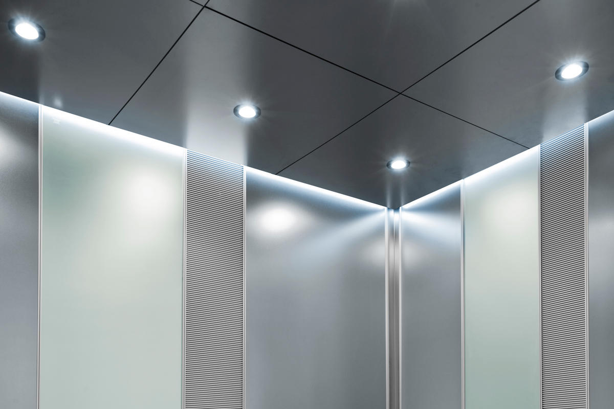 Elevator ceiling with LED downlights and LED perimeter accent lighting