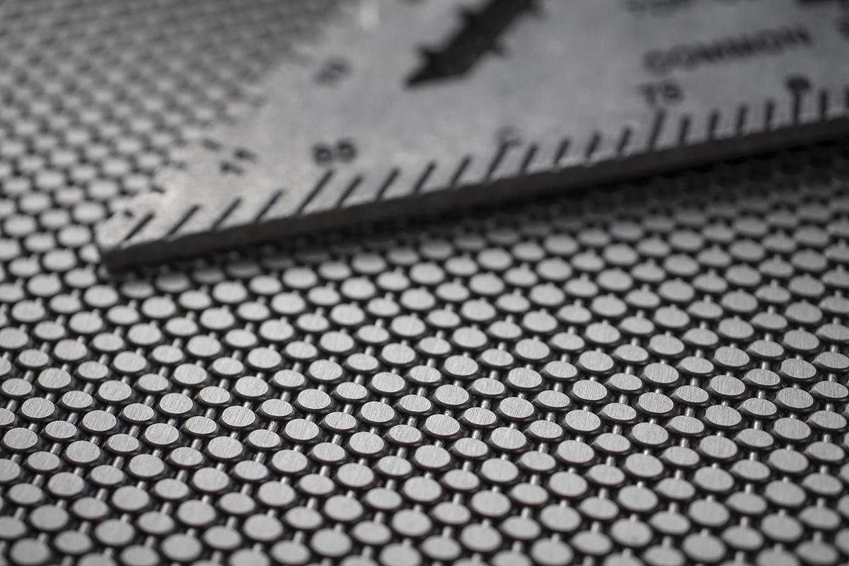 Linq Woven Metal shown with Sum CrossLinq pattern in Stainless Steel