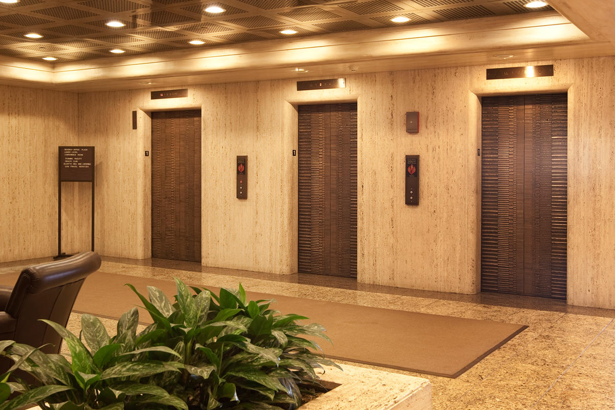 Bonded Bronze With Dark Patina And Crete Pattern At Des Plaines Office Building