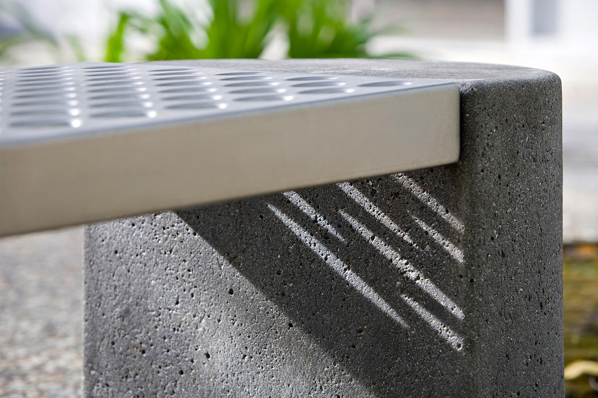 Foundation Bench Shown With Half Round Concrete Ends And Stainless Steel  Seat With Sandstone Finish