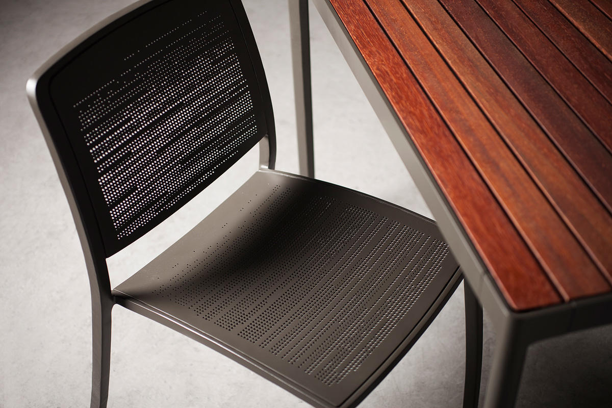 Avivo Chair shown with Slate Texture powdercoat and Riva perforation pattern