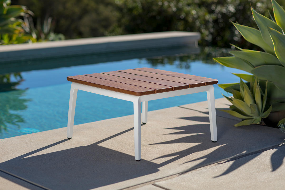 Vaya side table shown with white texture powdercoated frame and fsc 100 cumaru hardwood slats