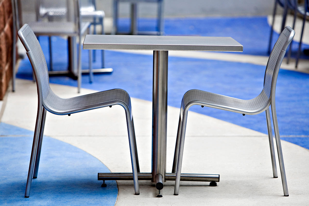 Cross Table shown with square Sandstone Stainless Steel table top
