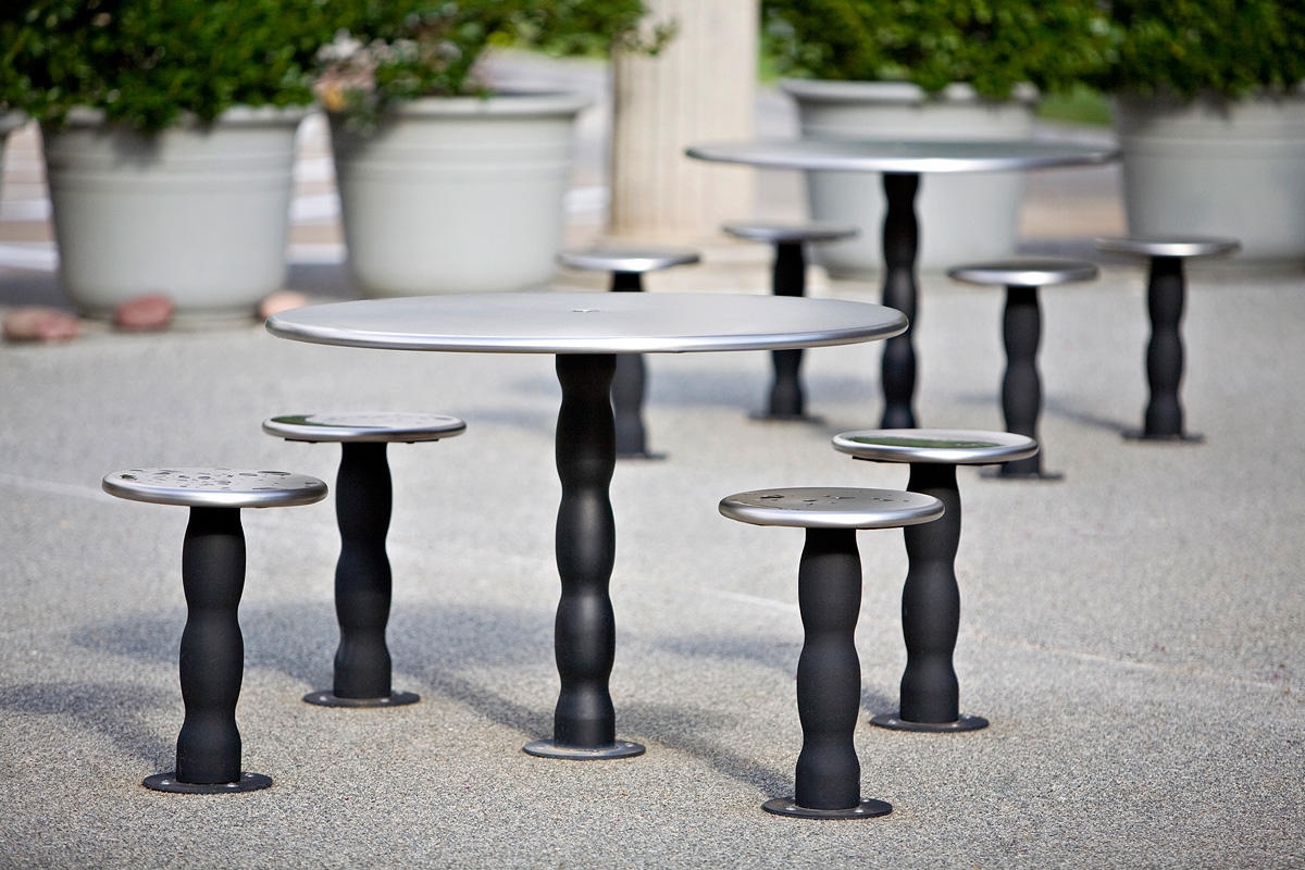 Wave Tables & Seats shown with Stainless Steel tops in Sandstone finish