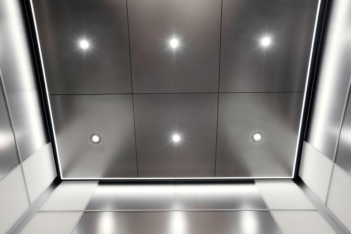 Elevator ceilings architectural formssurfaces levele 103 elevator interior with main panels in stainless steel with seastone dailygadgetfo Image collections