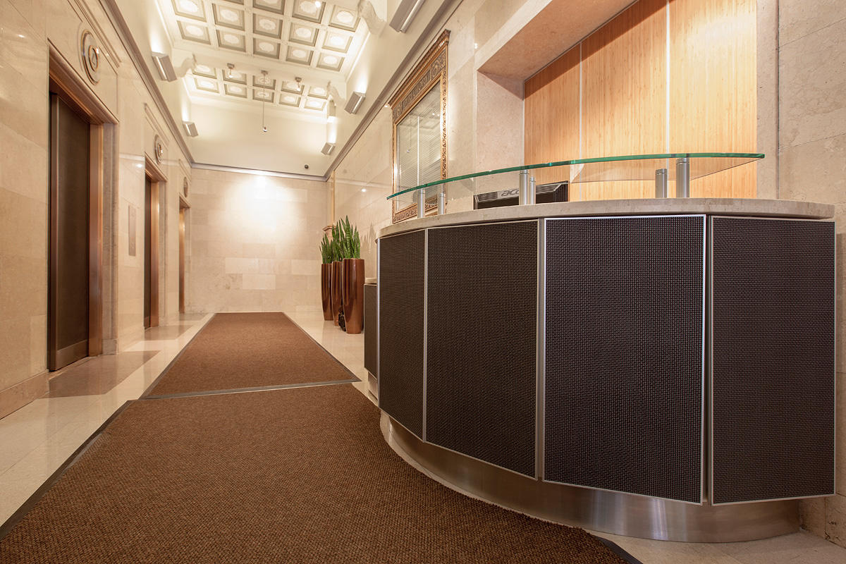 Reception desk and elevator doors in Bonded Nickel Silver with Dark Patina