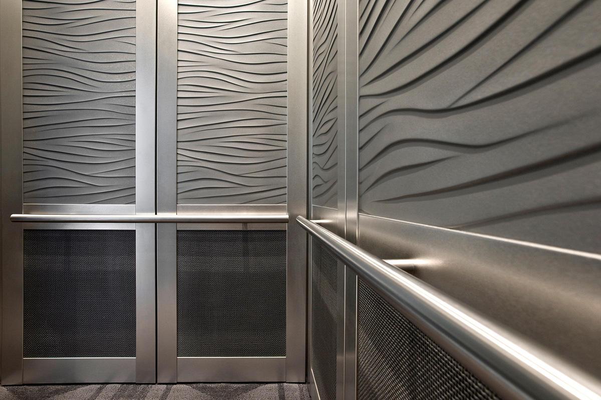 LEVELc-2000N Elevator Interior with upper panels in Bonded Aluminum with Natu