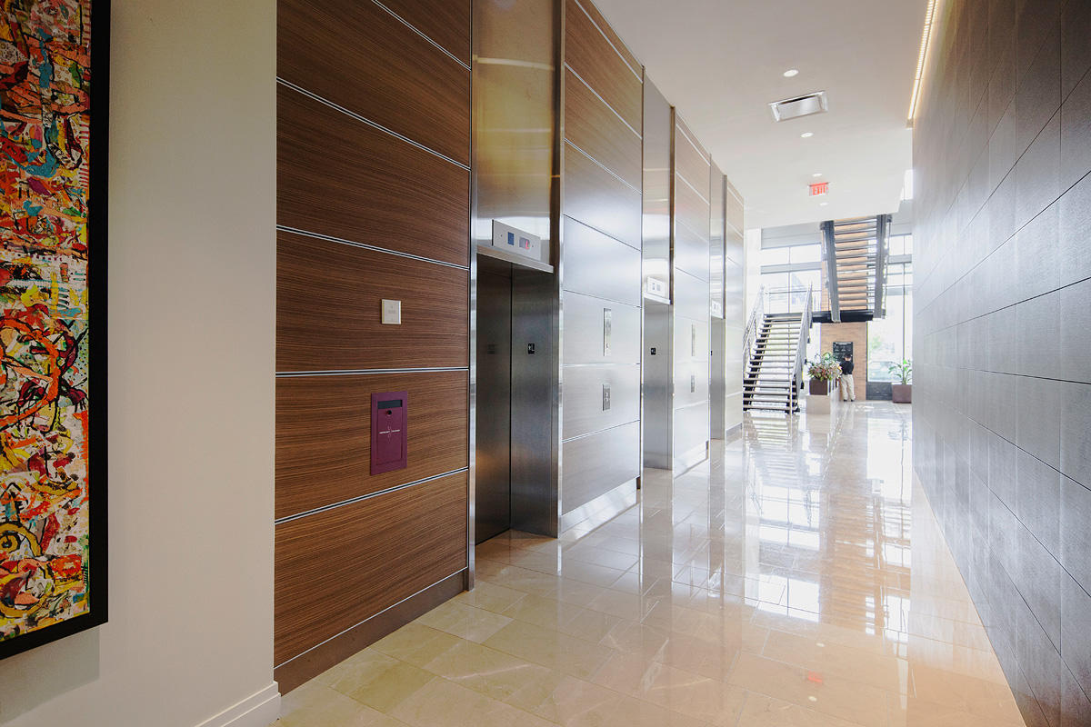 LEVELe Wall Cladding System with Capture panels; insets in custom wood veneer