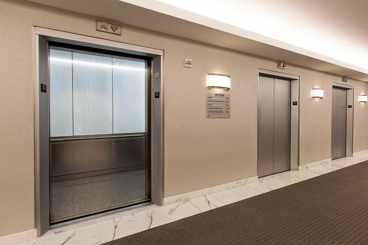 LEVELe Elevator Interior with LightPlane Panels in VIviGraphix Graphica glass wi