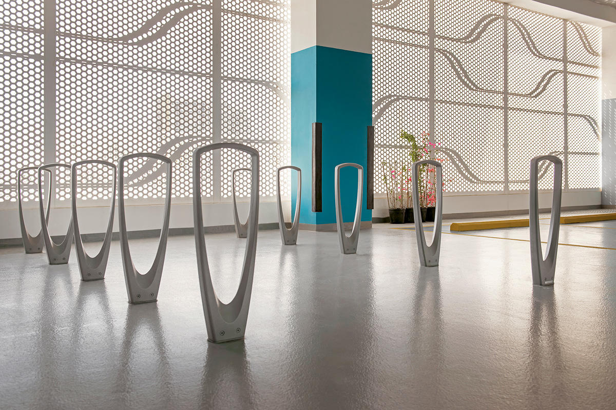 Trio Bike Racks shown with Aluminum Texture powdercoat at Al Hadeel Residential