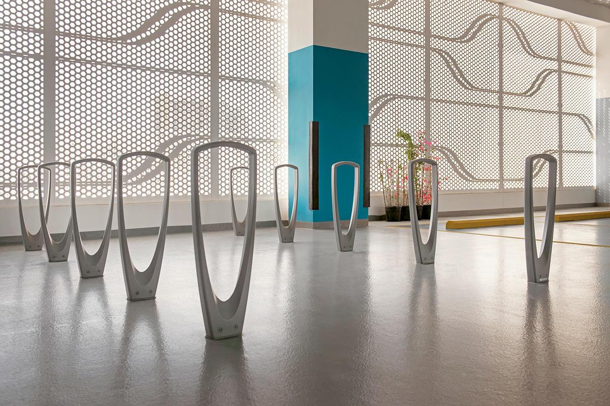 Trio Bike Racks shown with Aluminum Texture powdercoat at Al Hadeel Residential
