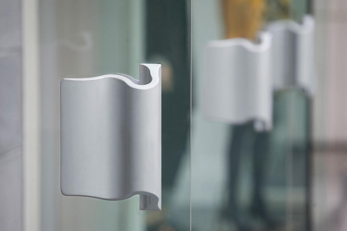 Wave Door Pulls shown in Clear Matte Aluminum at Bebe, Vancouver, BC, Canada