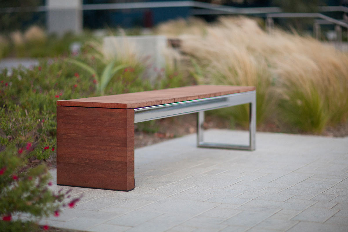 Duo Bench shown with Polished Stainless Steel frame and FSC® 100% hardwood