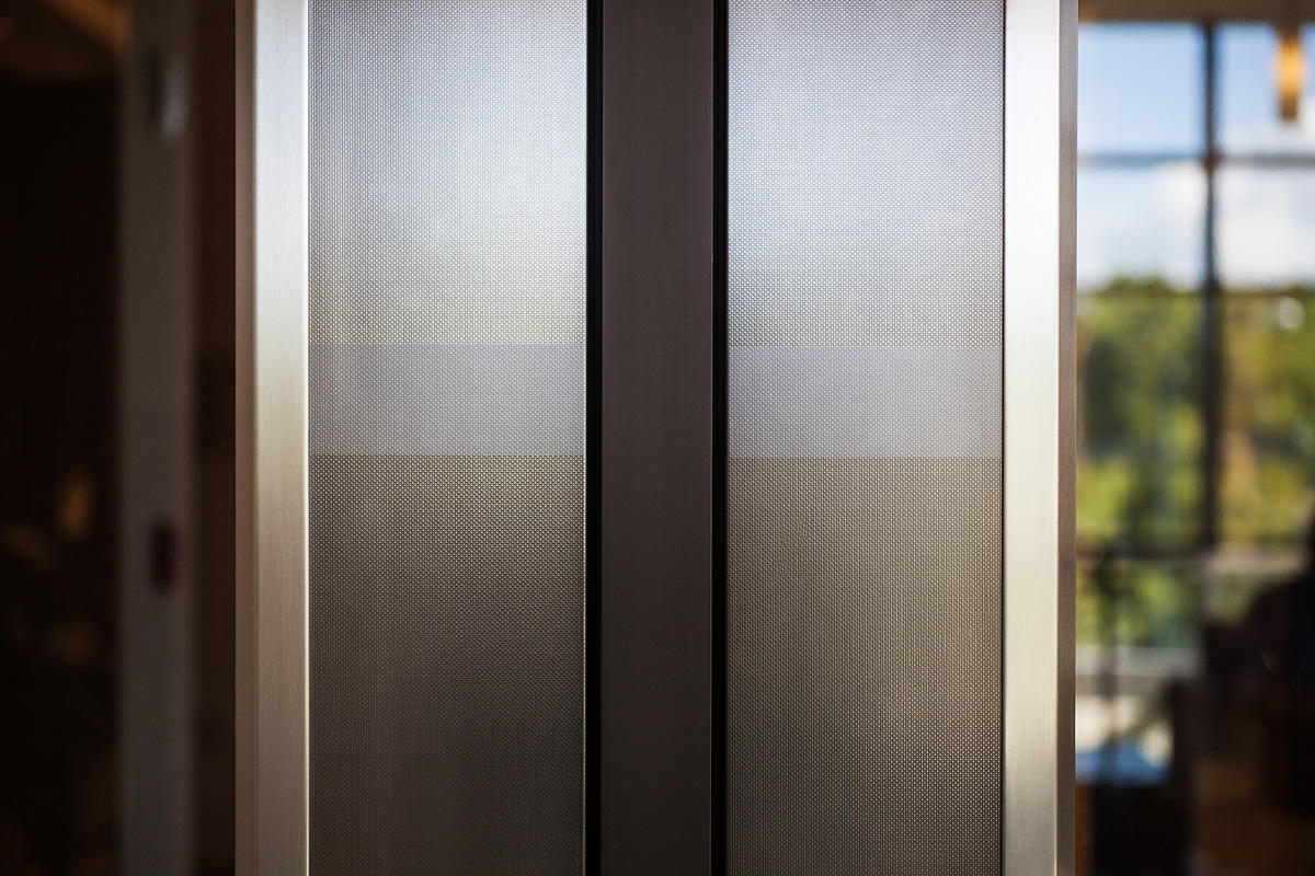 Doors in Fused Nickel Silver with Linen finish and custom Eco-Etch pattern