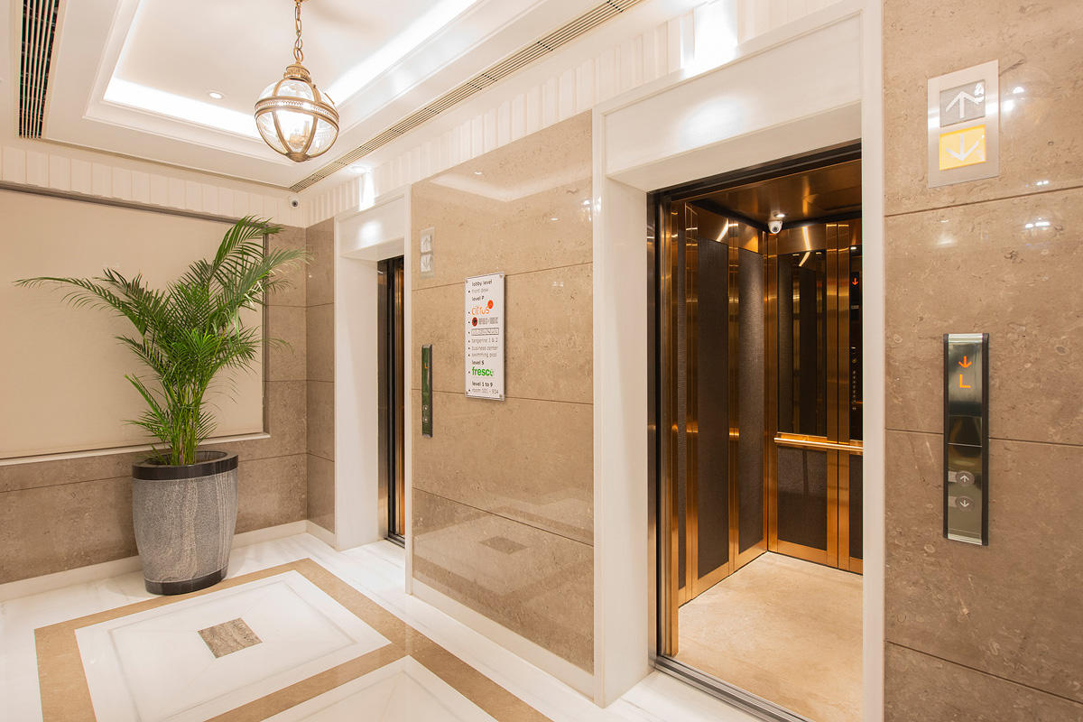 LEVELc-2000 Elevator Interior with upper panels in Bronze Mirror Glass; lower pa