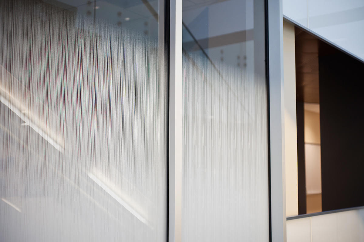 Partition wall shown in ViviGraphix Gradiance glass with custom interlayer