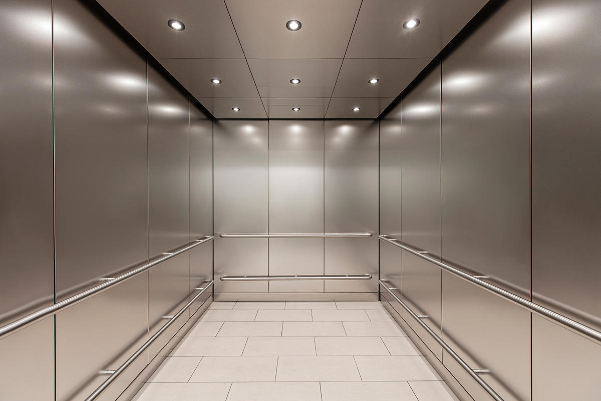LEVELc-1000 Elevator Interior in Stainless Steel with Seastone finish