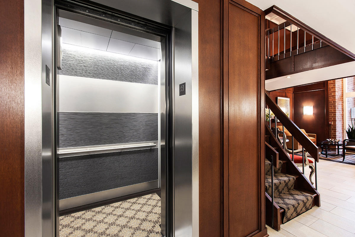 LEVELe-104 Elevator Interior with main panels in Bonded Aluminum