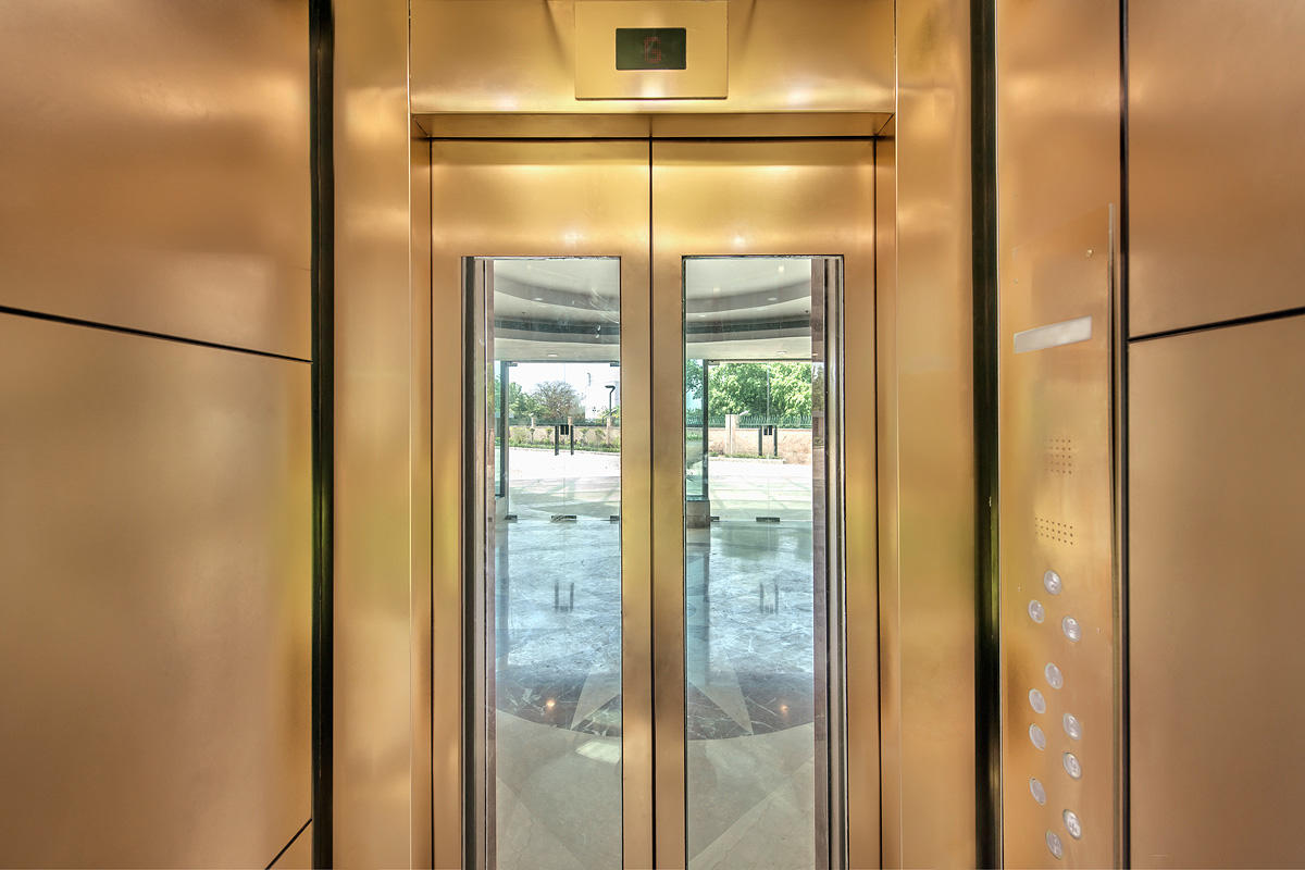 LEVELe-105 Elevator Interior with panels in Fused Bronze with Linen finish