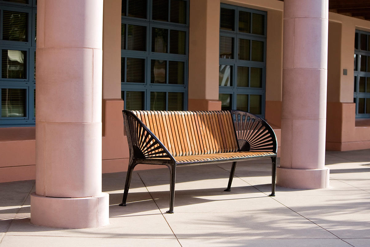 Copenhagen Bench shown with Black Texture powdercoated frame and FSC 100% Ipé