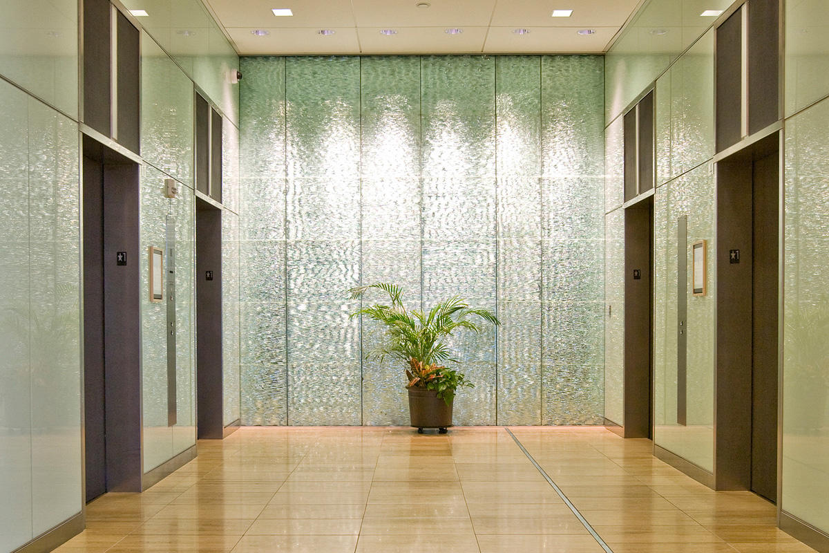 Elevator doors and transoms shown in Bonded Nickel Silver, Dark, Charleston