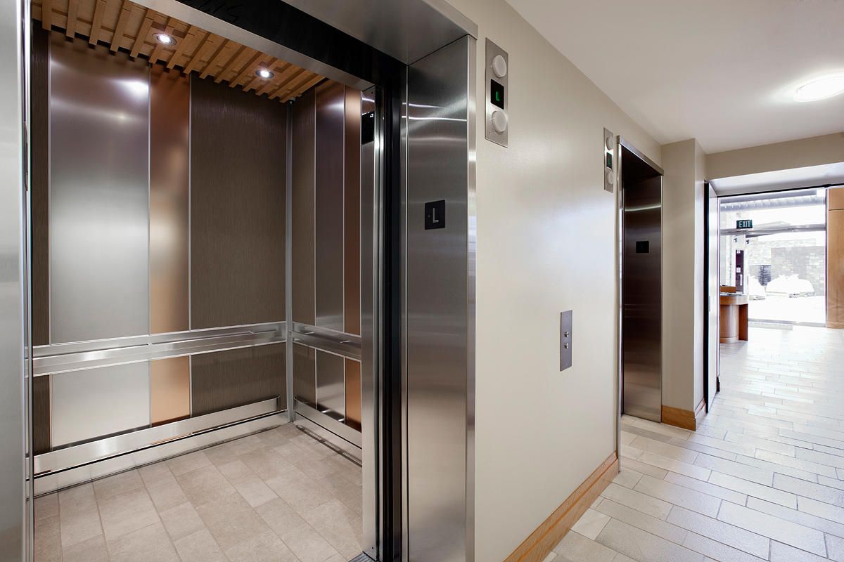 LEVELe-101 Elevator Interior with main panels in Bonded Bronze with Natural