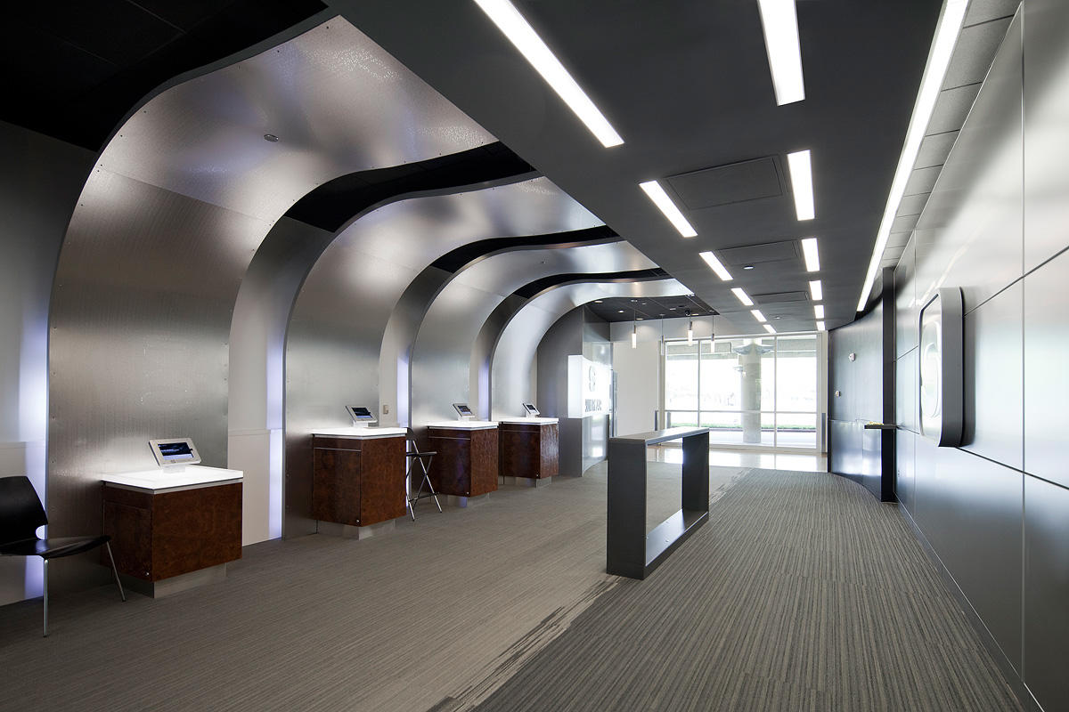 Wall panels shown in Stainless Steel with Mirror finish and City Lights Eco-Etch pattern at Silvercar - DFW Dallas Texas & Silvercar - DFW | Forms+Surfaces azcodes.com