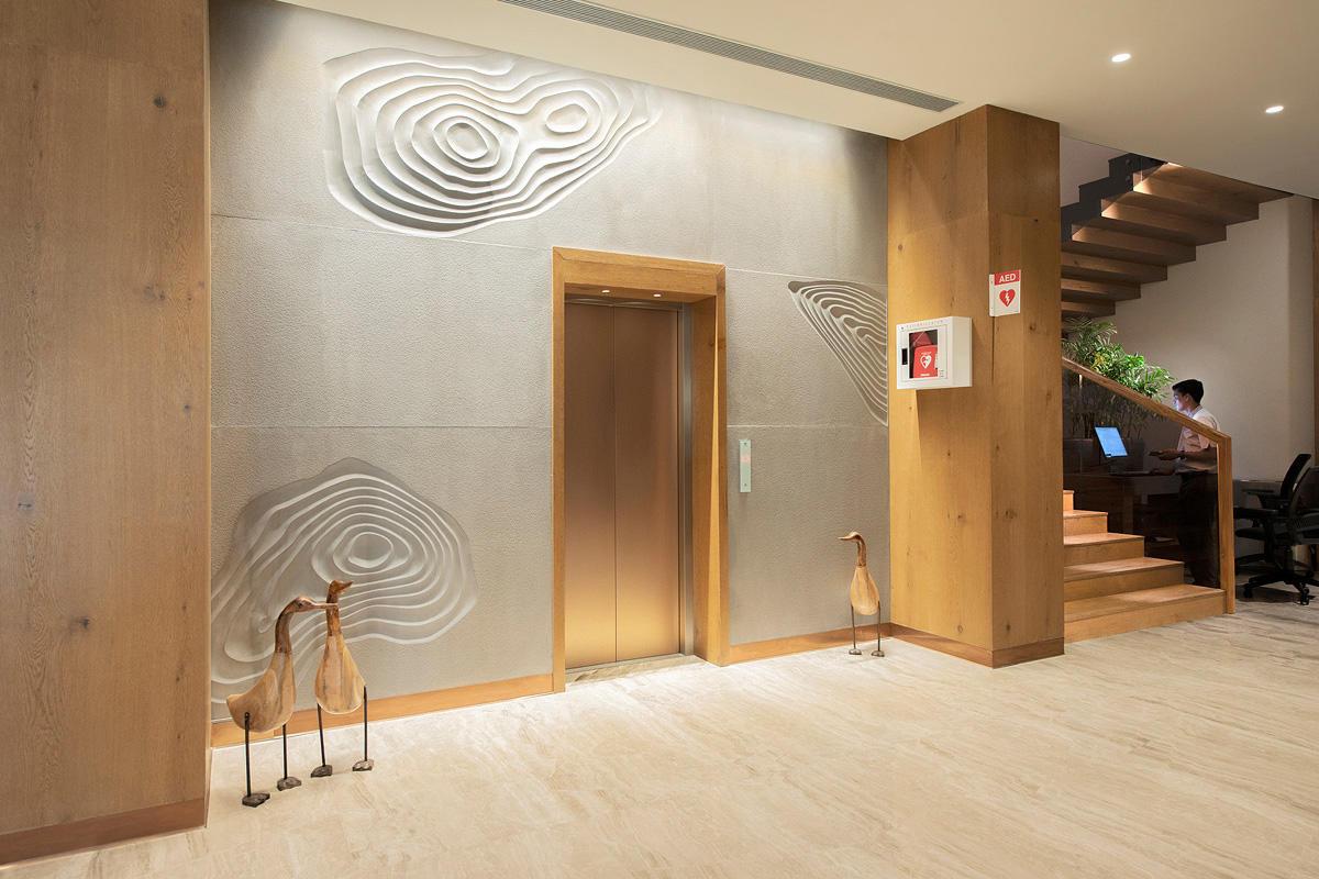 Elevator doors in Fused Bronze with Seastone finish at Sheraton Grand Chen