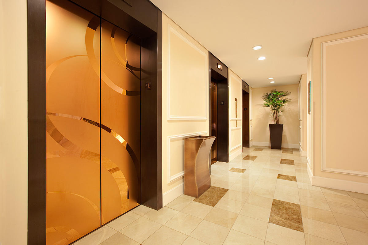 Elevator doors shown in Fused Bronze with Mirror finish and ECO205H Eco-Etch pat
