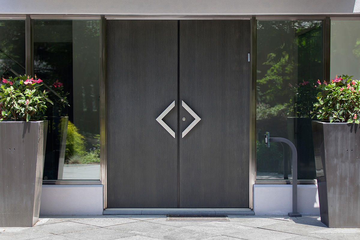 Stein residence forms surfaces for Metal entry doors
