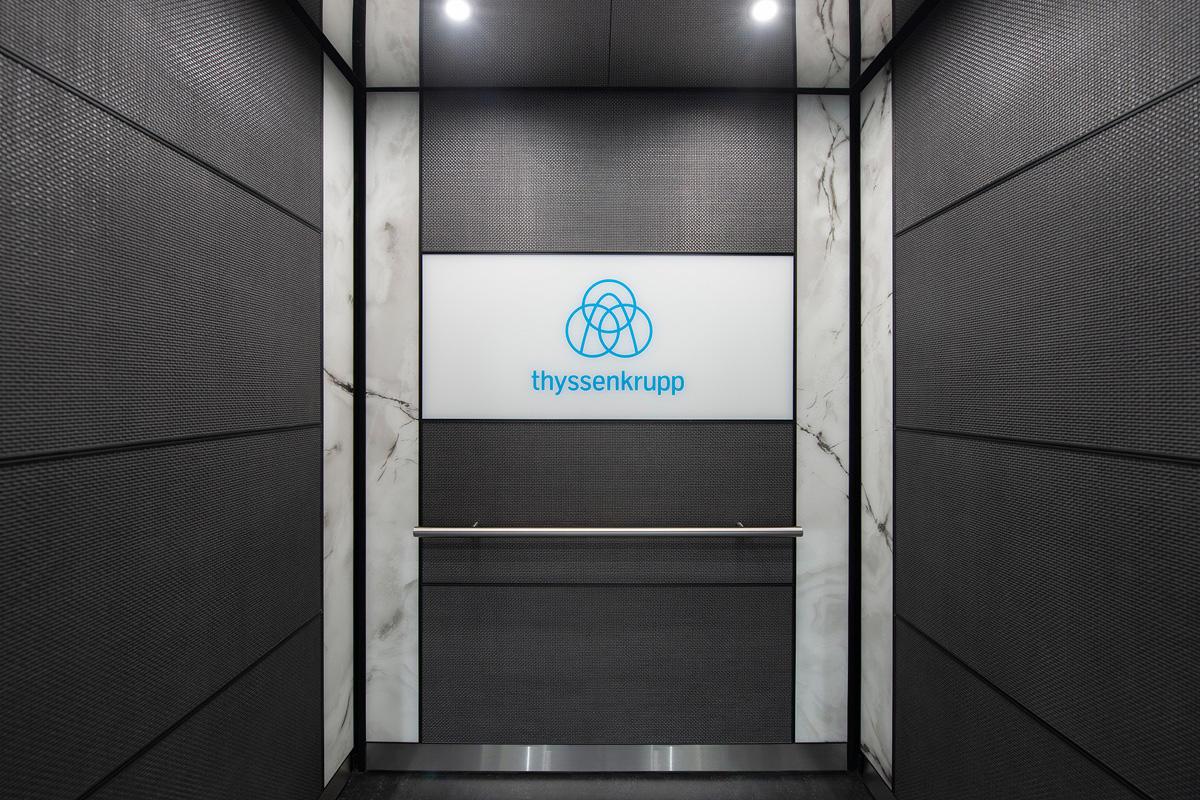 LEVELe-102 Elevator Interior with customized panel layout; Minimal panels in Bon