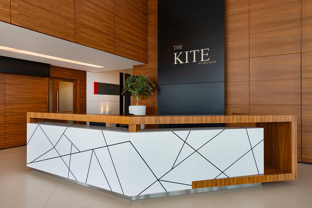 Wall panels in Bonded Quartz, White, with Mara pattern at The Kite Residences