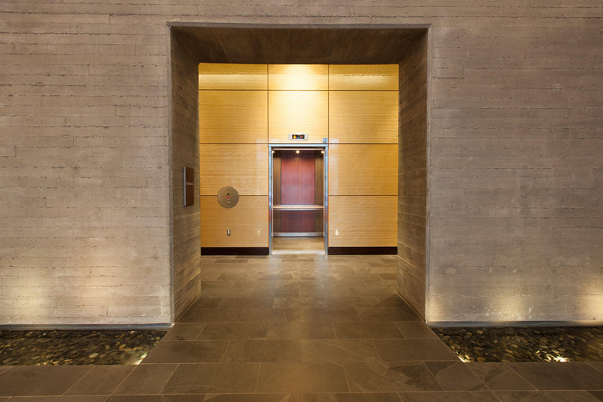 LEVELe-105 Elevator Interior with main panels in Bonded Bronze with Dark  Patina and Rain pattern; accent panels in custom wood veneer at The Wyatt,  ... - The Wyatt Forms+Surfaces
