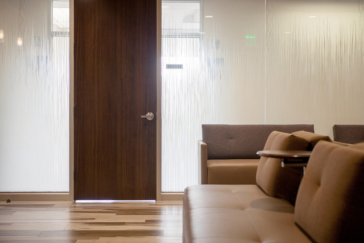 Partition wall shown in ViviGraphix Gradiance glass with Switchgrass interlayer
