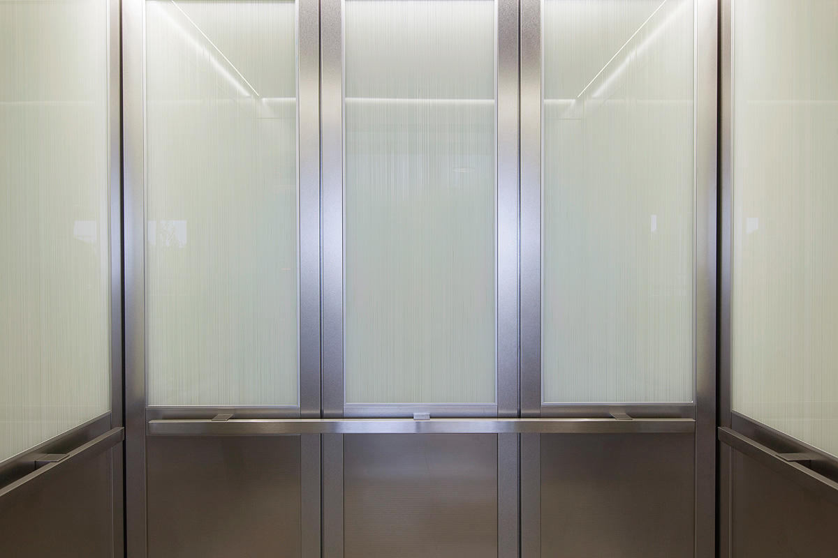 LEVELc-2000N Elevator Interiors with panels in ViviGraphix Graphica glass