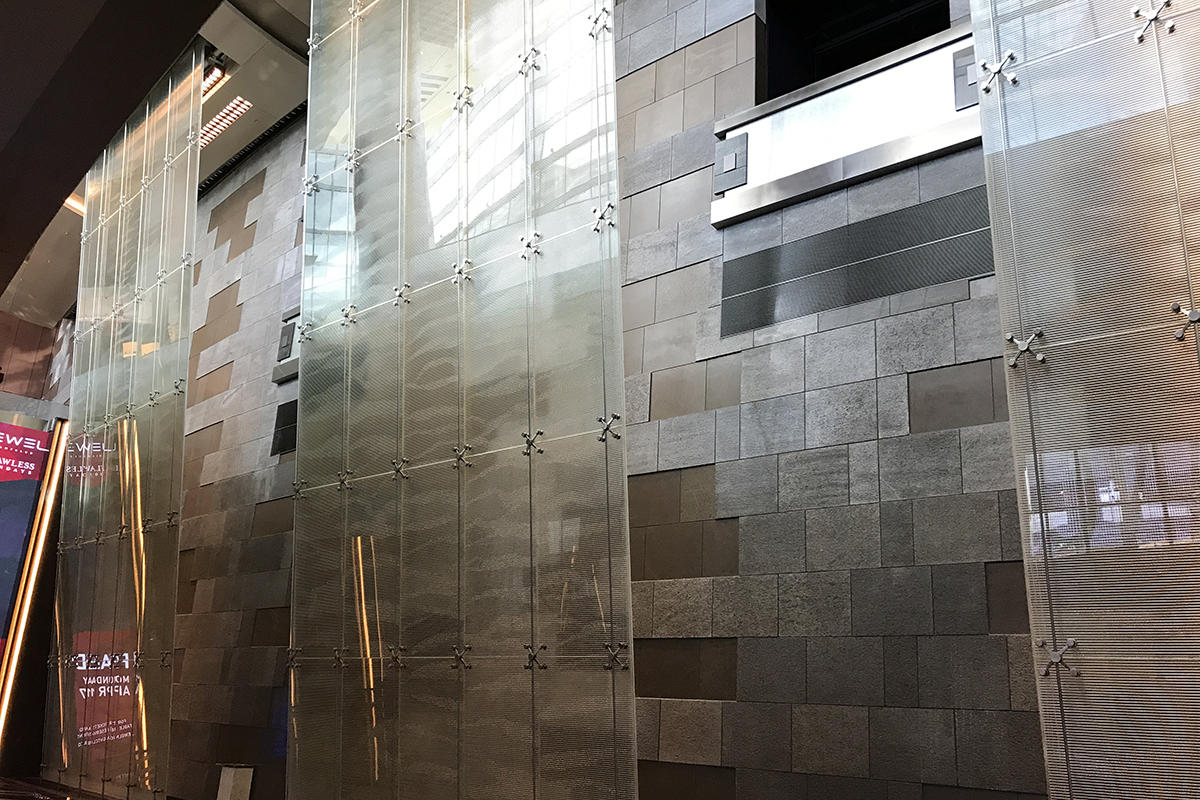 Water feature with BermanGlass Profile Kiln Cast Glass in custom texture at Aria
