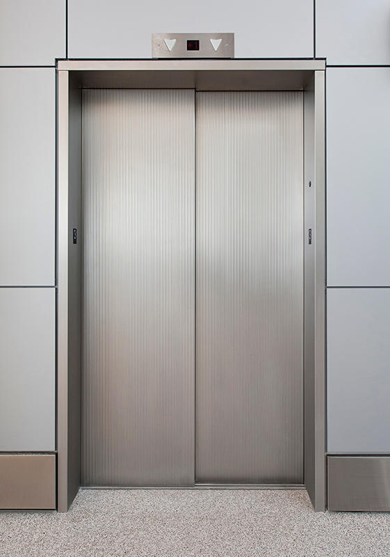 elevator doors. stainless steel elevator doors in seastone finish with dallas impression pattern forms+surfaces