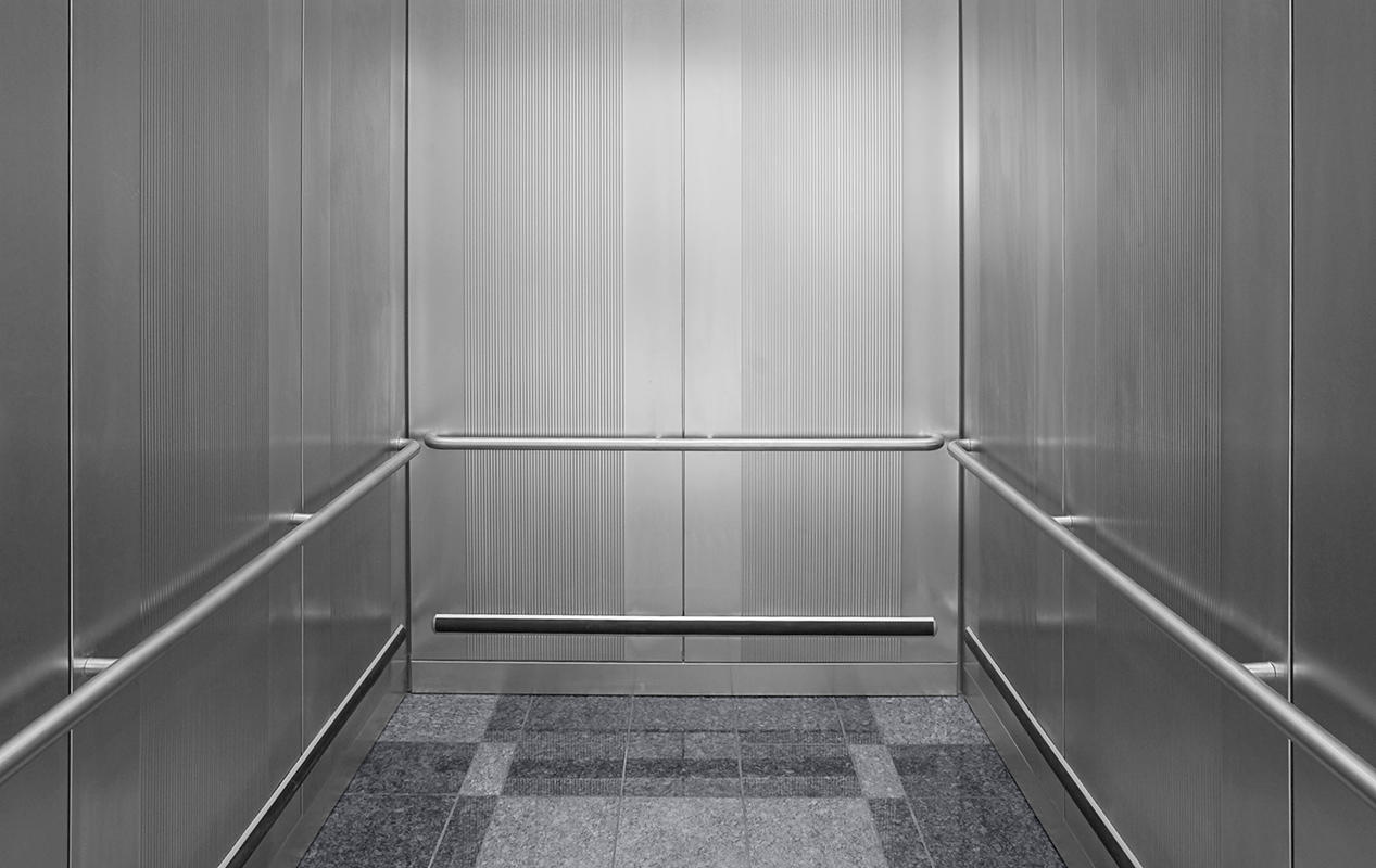 CabForms 1000 A Elevator Interior In Stainless Steel With Sandstone Finish