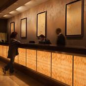 Registration desk in backlit ViviStone Honey Onyx